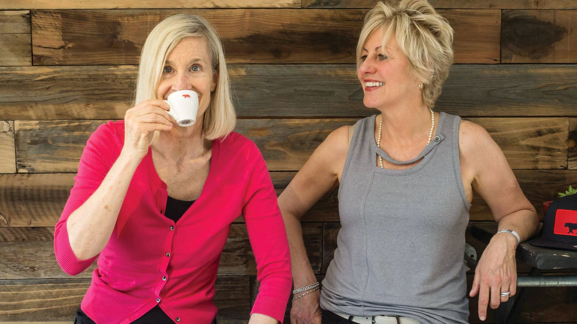 Equator Coffees & Teas founders Brooke McDonnell (left) and Helen Russell (right) with their Bengal tiger-branded blends in Northern California.