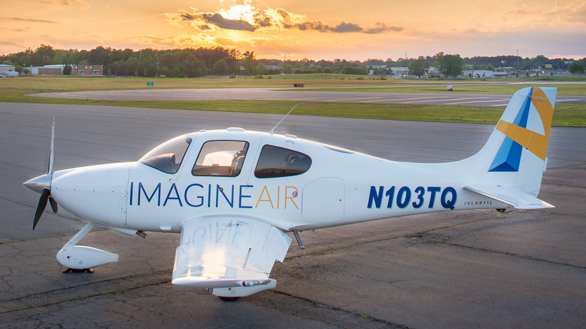 A Cirrus SR22-GTS, ImagineAir's aircraft of choice, sits on a tarmac at the company's home base in Georgia.