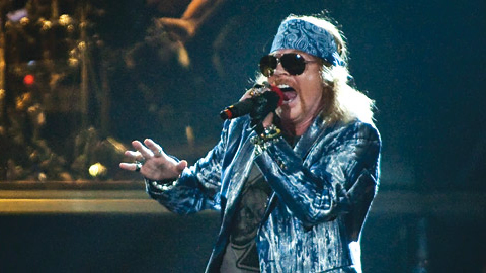<Strong>Strate-strate-strate-gy-gy-gy!: </strong>Axl Rose of Guns N' Roses performs on stage on the opening night of the Chinese Democracy UK tour.