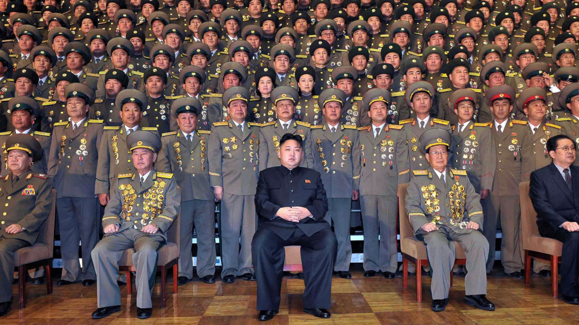 North Korean leader Kim Jong-un during a photo session with participants in the national meeting of chiefs of branch social security stations at an undisclosed location in North Korea. November 27, 2012