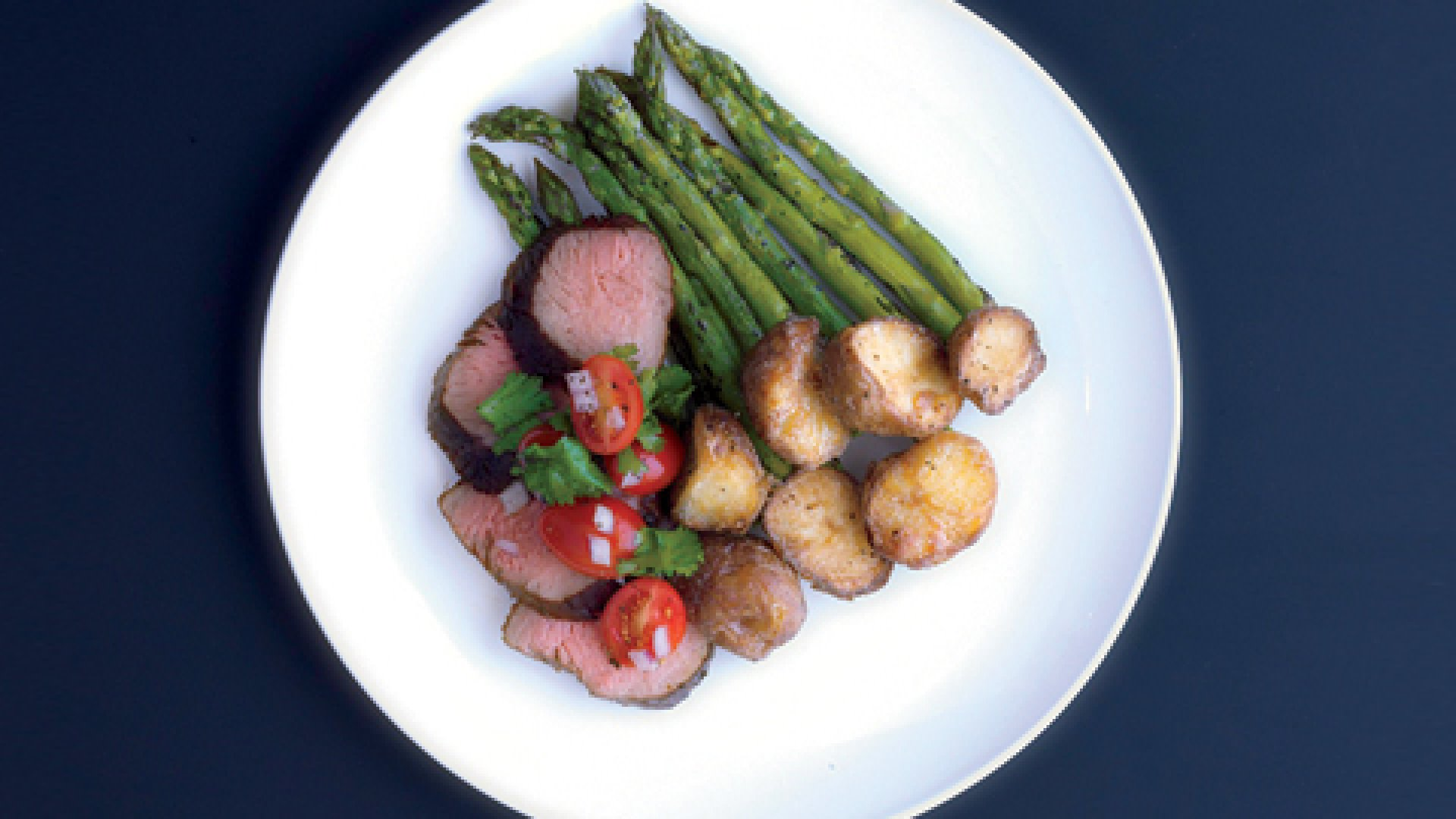 <b>Lunch is Served</b> One of Gastronaut's recent offerings: grass-fed beef, crispy potatoes, and grilled asparagus.