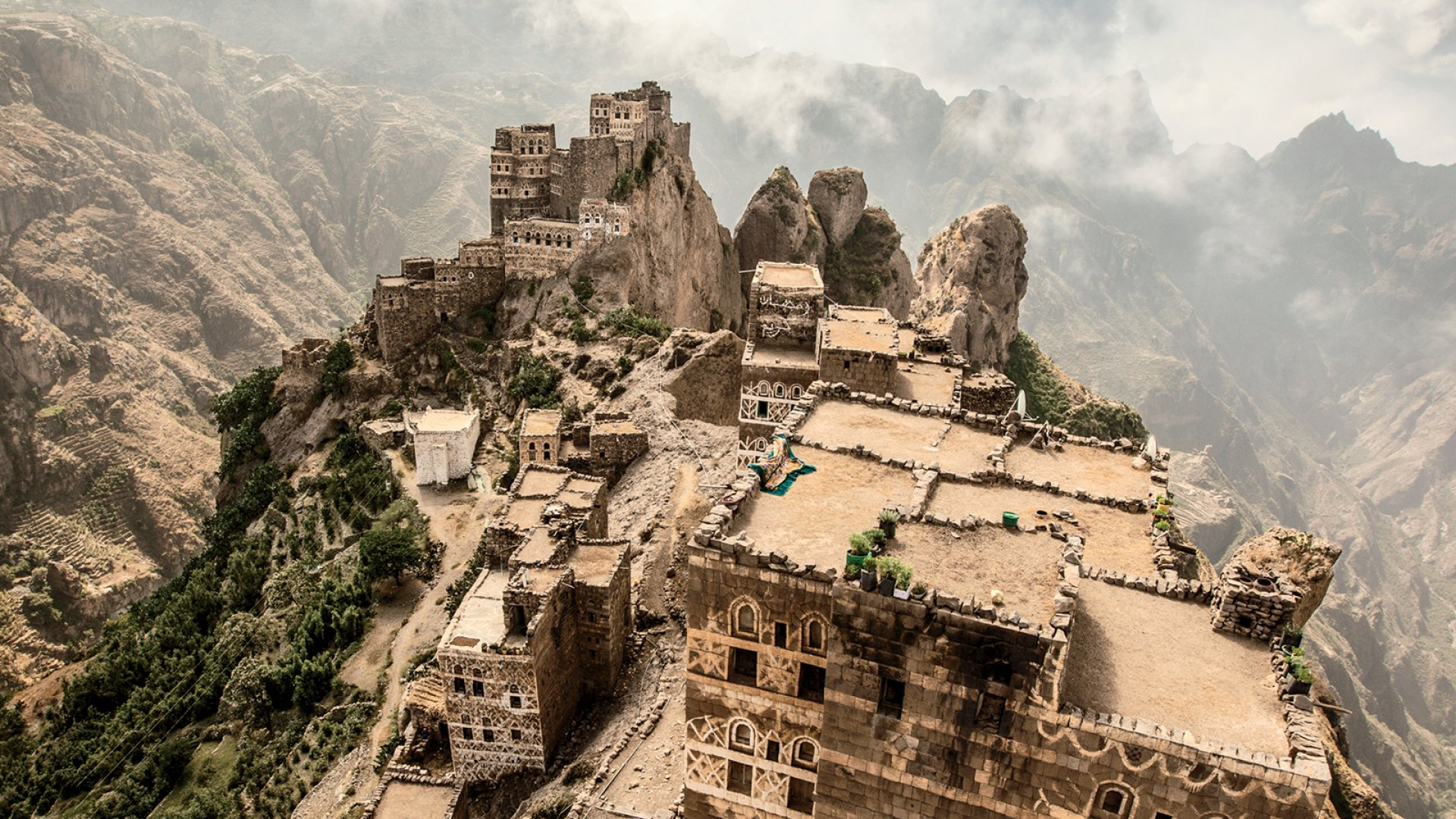 The mountain village of Al Hajjarah, southwest of San'a, Yemen. Port of Mokha founder Mokhtar Alkhanshali traveled throughout Yemen trying to find reliable sources of high-quality coffee beans that he could import to the United States. Then war broke out.