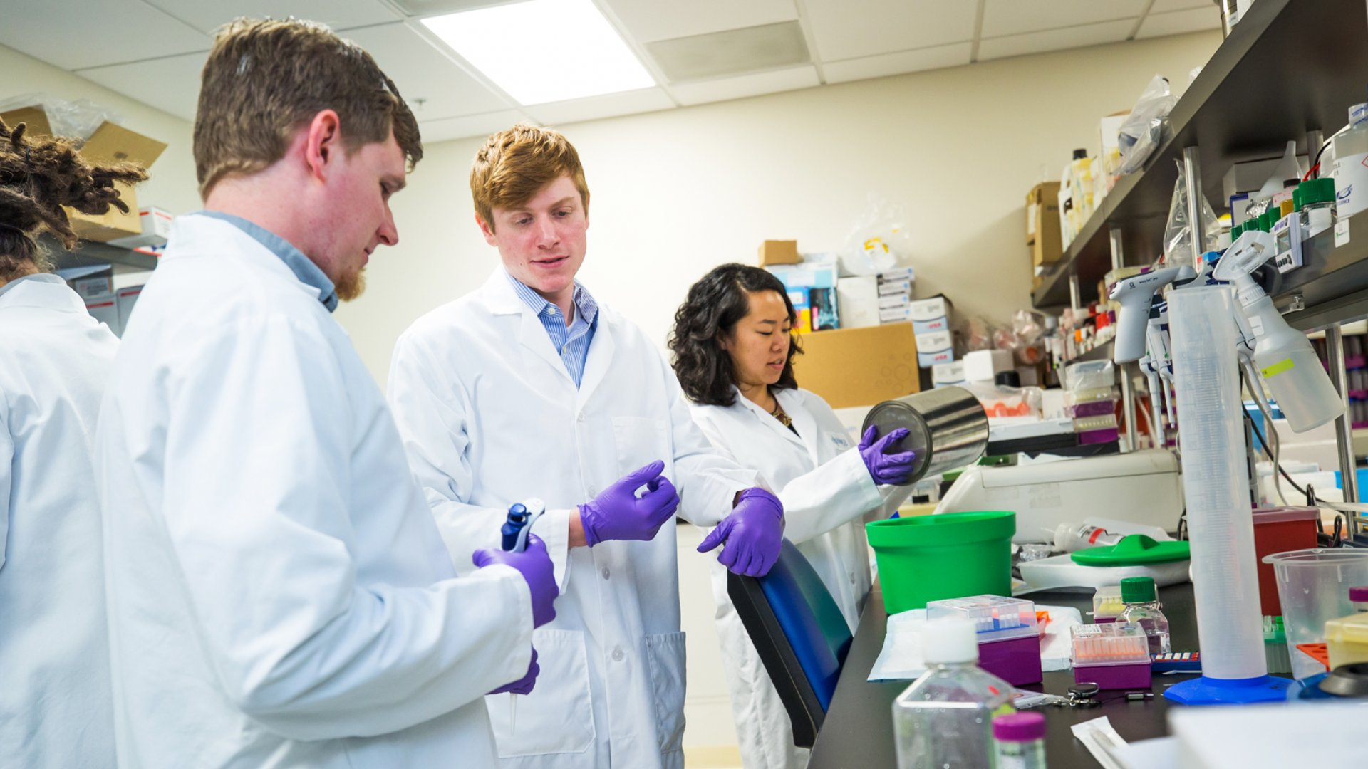 At work in a Mammoth Biosciences lab are (from left) research technician Pedro Galarza, RNA scientist James Broughton, co-founder and chief discovery officer Lucas Harrington, and co-founder and chief research officer Janice Chen.