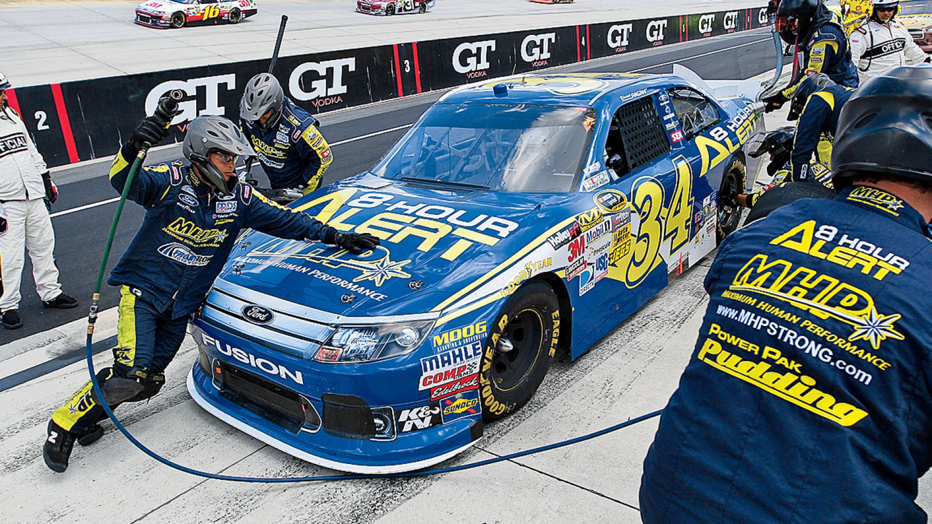 <b>Fill 'Er Up:</b> David Ragan, one of Front Row Motorsports' three drivers, pulls in for a pit stop at the Dover International Speedway.
