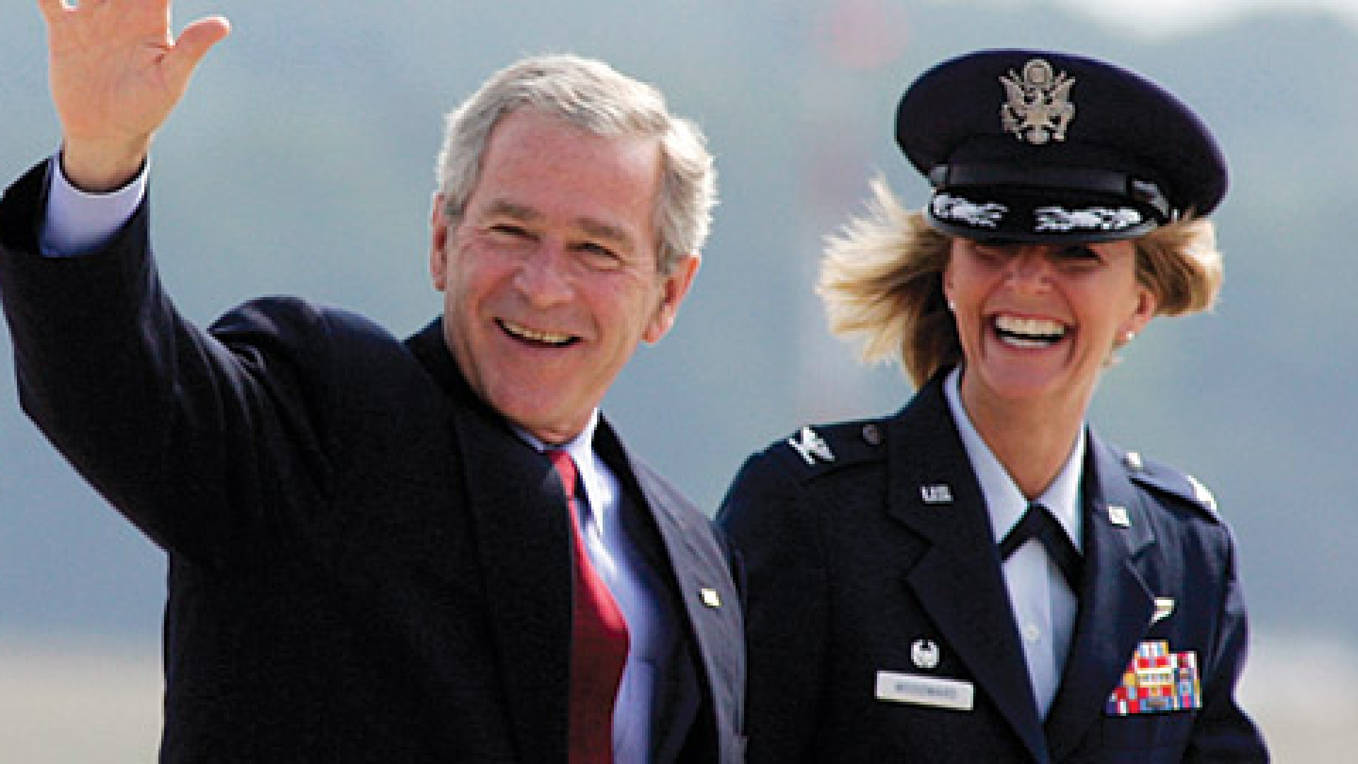 <strong>Up in the Air:</strong> Air Force Major General Margaret Woodward, (pictured with President Bush in 2007) is in command of the Libya air strikes.