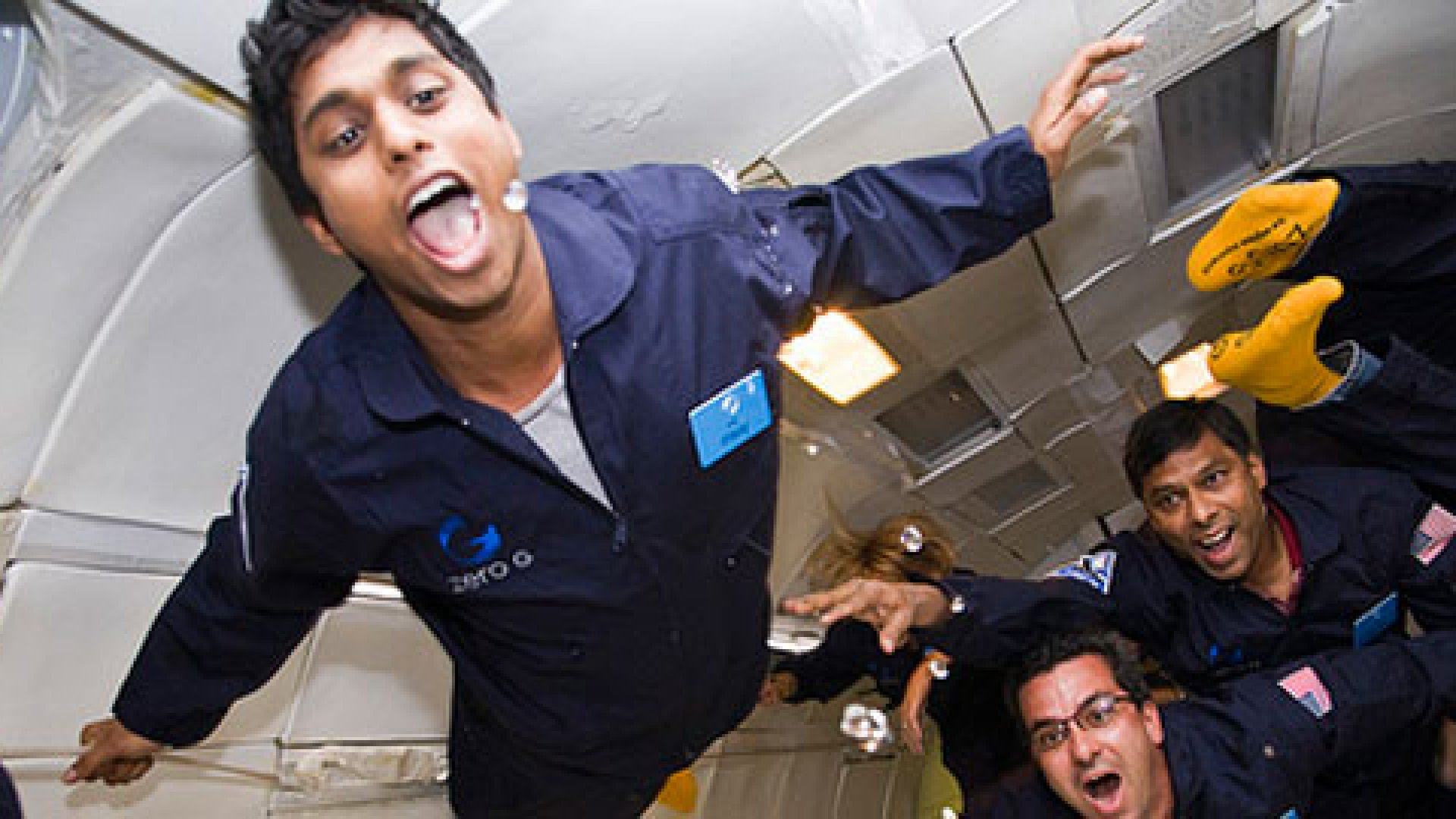 Ankur Jain (front) enjoying weightlessness with the ZERO-G experience with his father Naveen (back right).