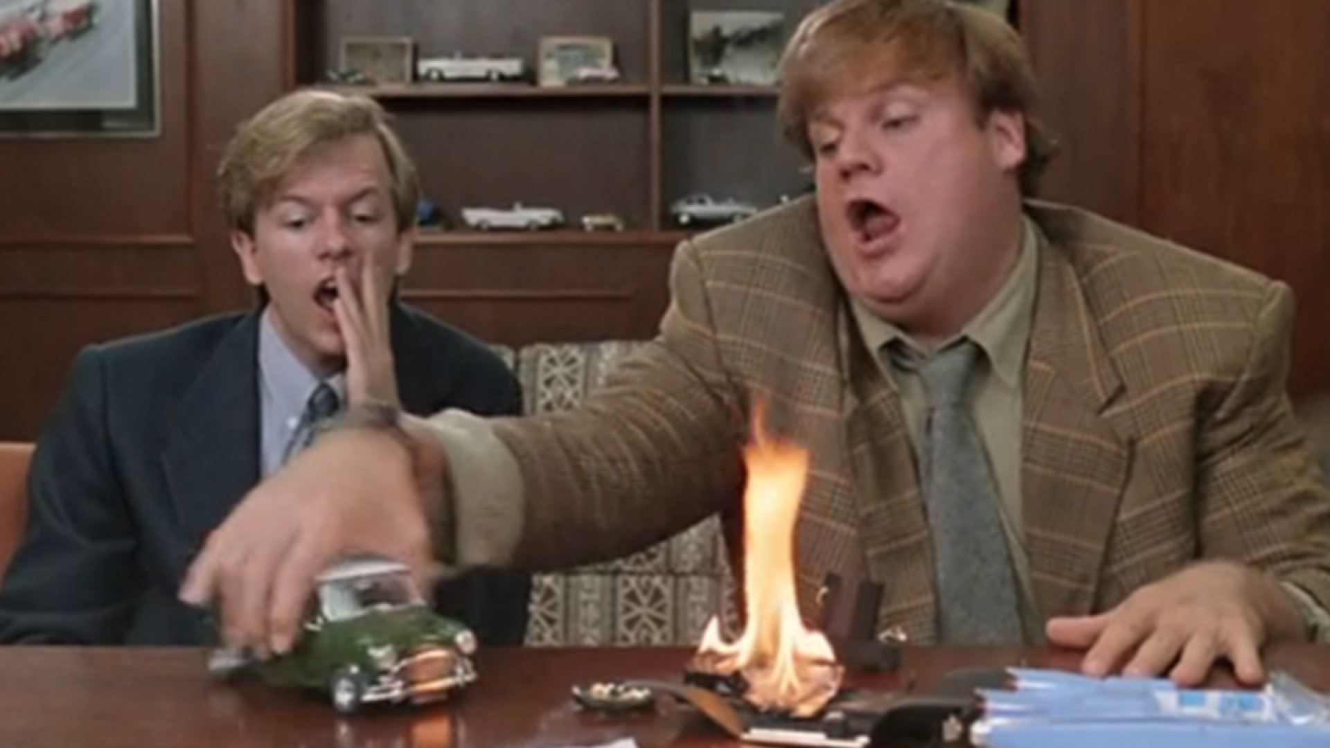 Chris Farley and David Spade in <i>Tommy Boy</i> waste an executive's time during a sales meeting.