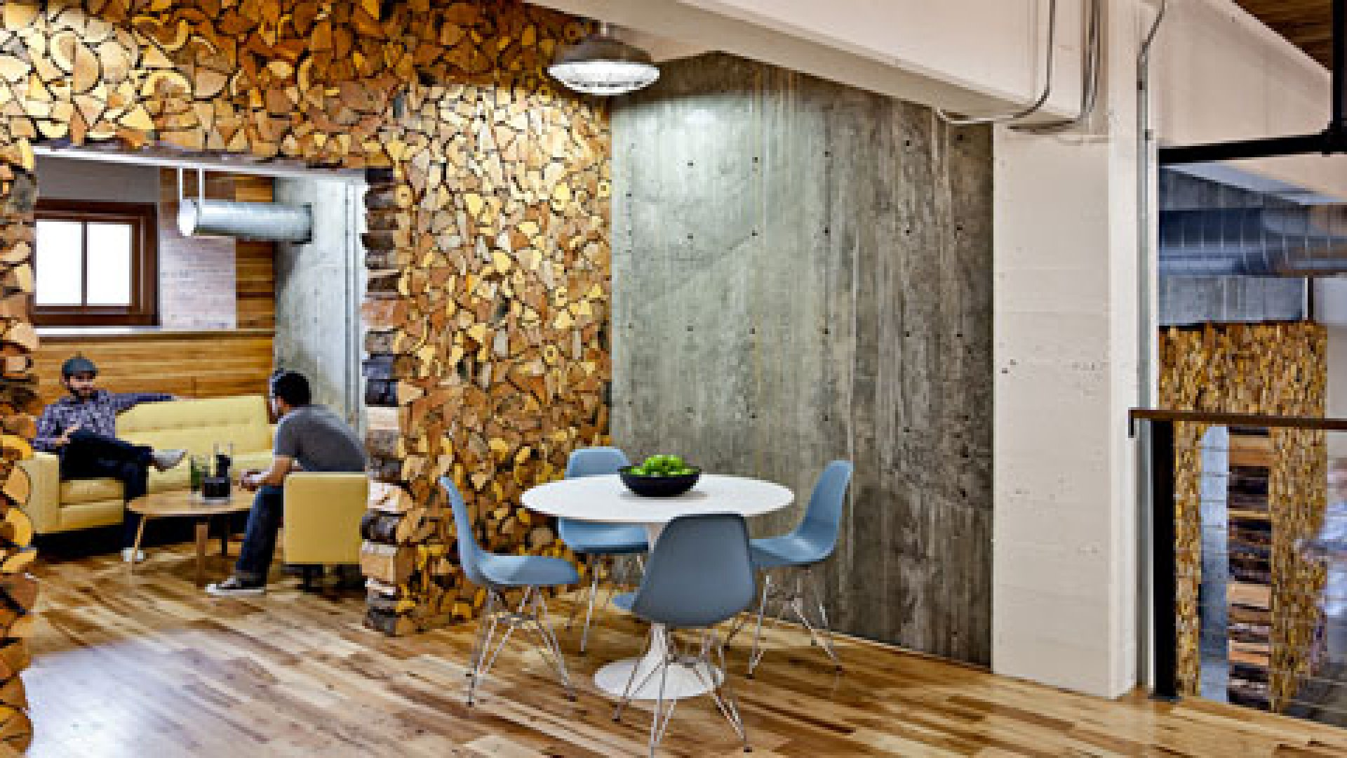 The Portland, Oregon, office of Parliament has more logs than a cabin. It also features plenty of raw concrete, huge open worktables, classic midcentury-modern chairs, and the odd bear rug for rustic charm.