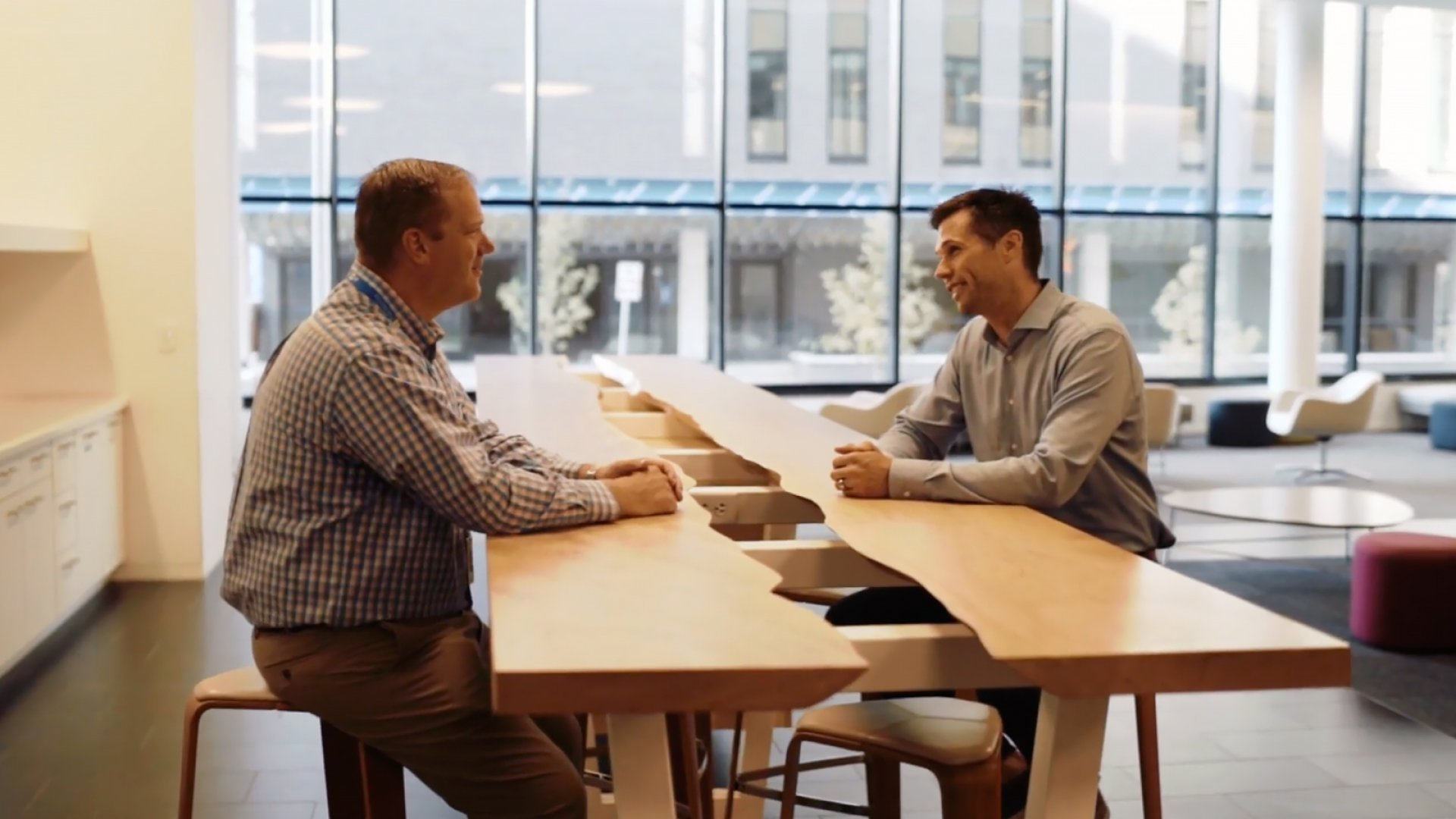 PhData CEO Ryan Bosshart (right) meets with Jeff Levy of the National Marrow Donor Program.