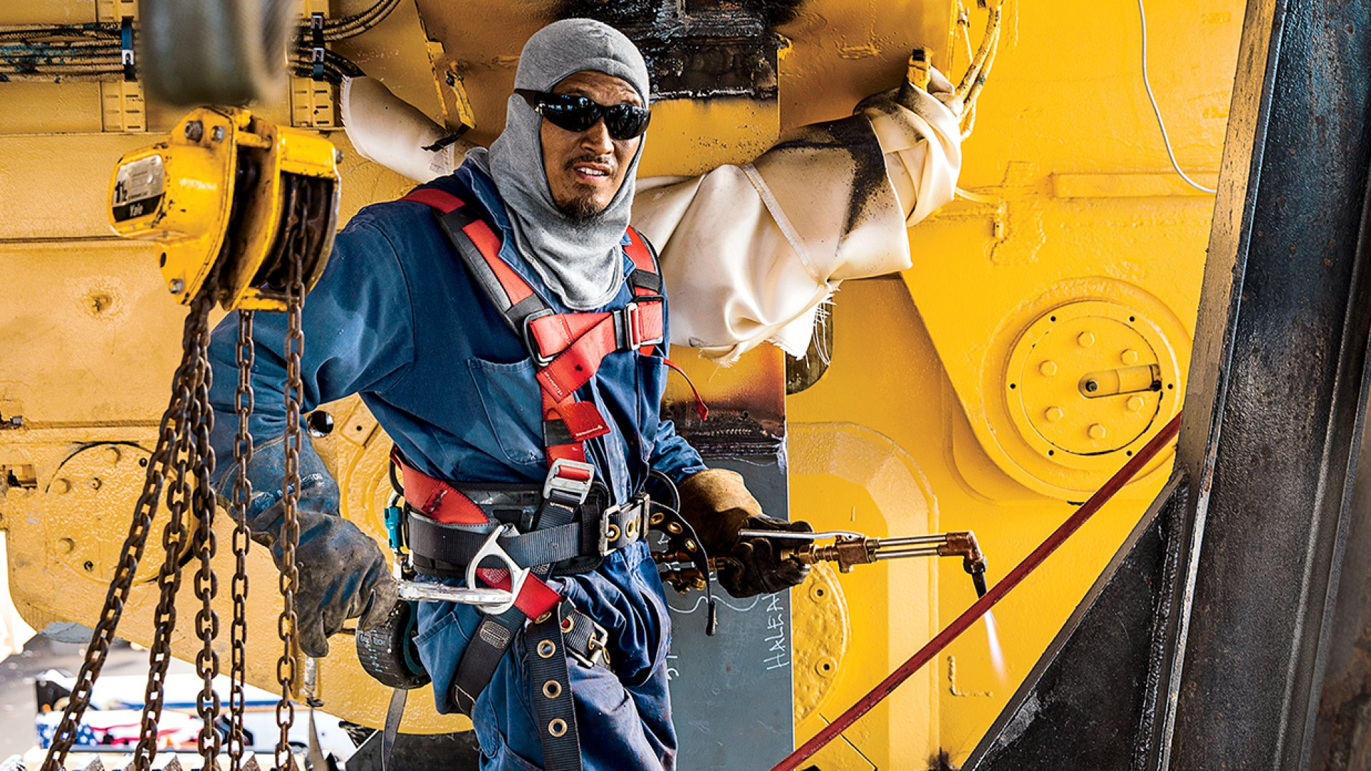 A Regal Service Company welder works on the container vessel <em>Haleakala</em> in Honolulu Harbor.