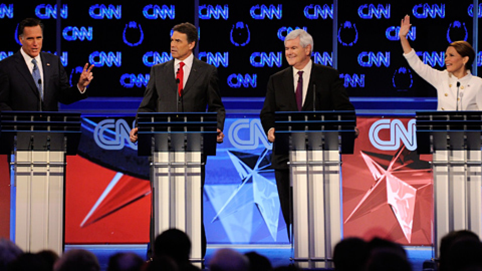 <strong>CONTENDERS</strong> Former Massachusetts Gov. Mitt Romney, Texas Gov. Rick Perry, former Speaker of the House Newt Gingrich (L) and U.S. Rep. Michele Bachmann (R-MN) participate during the Republican presidential debate, October 18, 2011 in Las Vegas, Nevada.