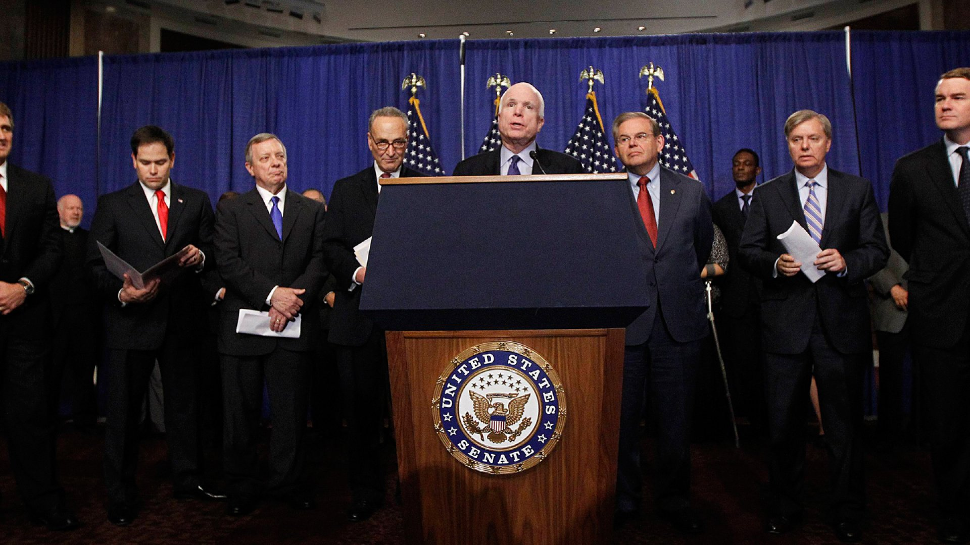 <strong>Gang of Eight</strong>: Senators Jeff Flake, a Republican from Arizona; Marco Rubio, a Republican from Florida; Dick Durbin, a Democrat from Illinois; Chuck Schumer, a Democrat from New York; John McCain, a Republican from Arizona; Bob Menendez, a Democrat from New Jersey; Lindsay Graham, a Republican from South Carolina; and Michael Bennet, a Democrat from Colorado (pictured left to right), crafted comprehensive legislation to overhaul the immigration system.