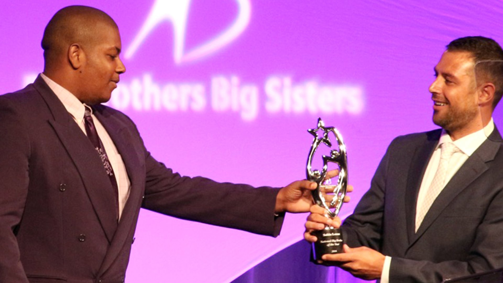 Sabin Lomac (right) receives the National Big Brother of the Year award from his little brother Lawrence Pittman at the Big Brothers Big Sisters of America National Conference Gala in Orlando, Fl. on June 29th. CREDIT: Courtesy of Big Brothers Big Sisters of America