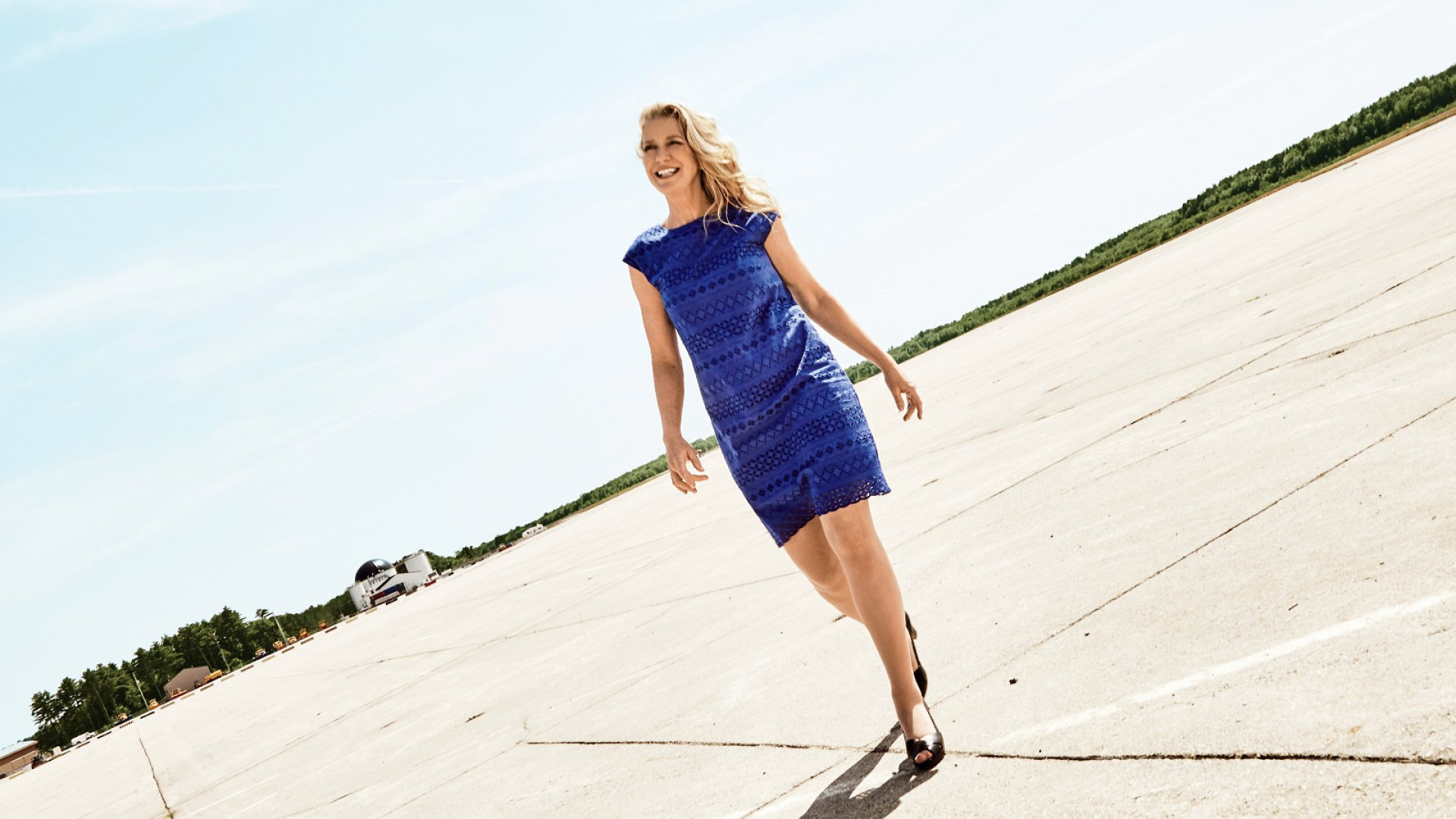 Heather Blease walking the runway at the decommissioned Brunswick Naval Air Station in Brunswick, Maine, which has been converted to a high-tech business and industrial park and includes the Savilinx offices.