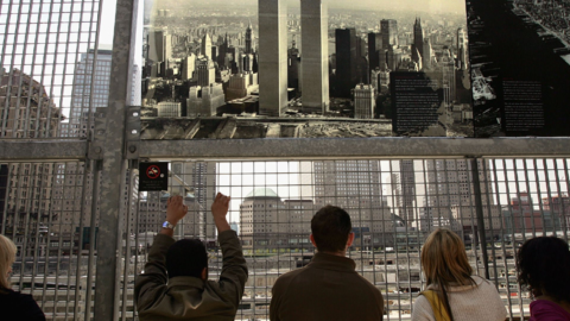 People look out at the former site of the World Trade Center.