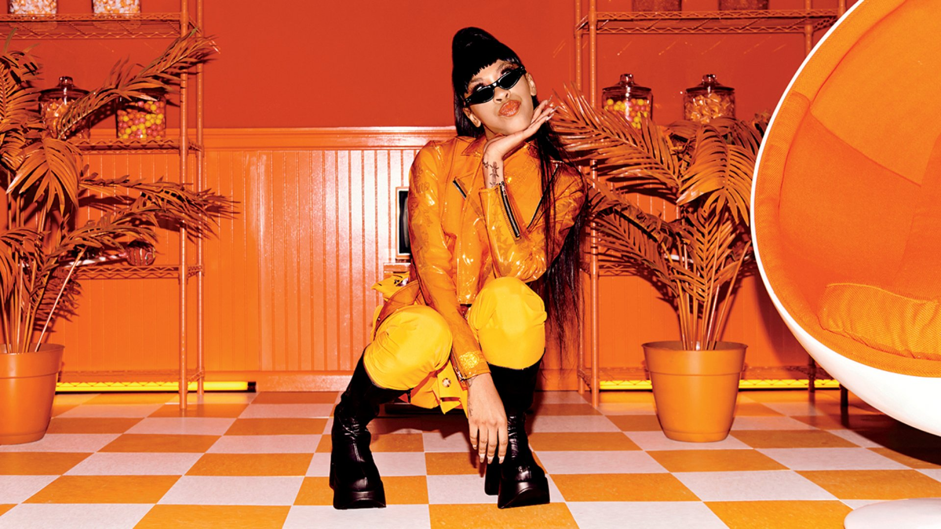 Rapper Rico Nasty channeling one of Skullcandy's 12 Moods lines, the tangerine-colored Bold. She qualifies.