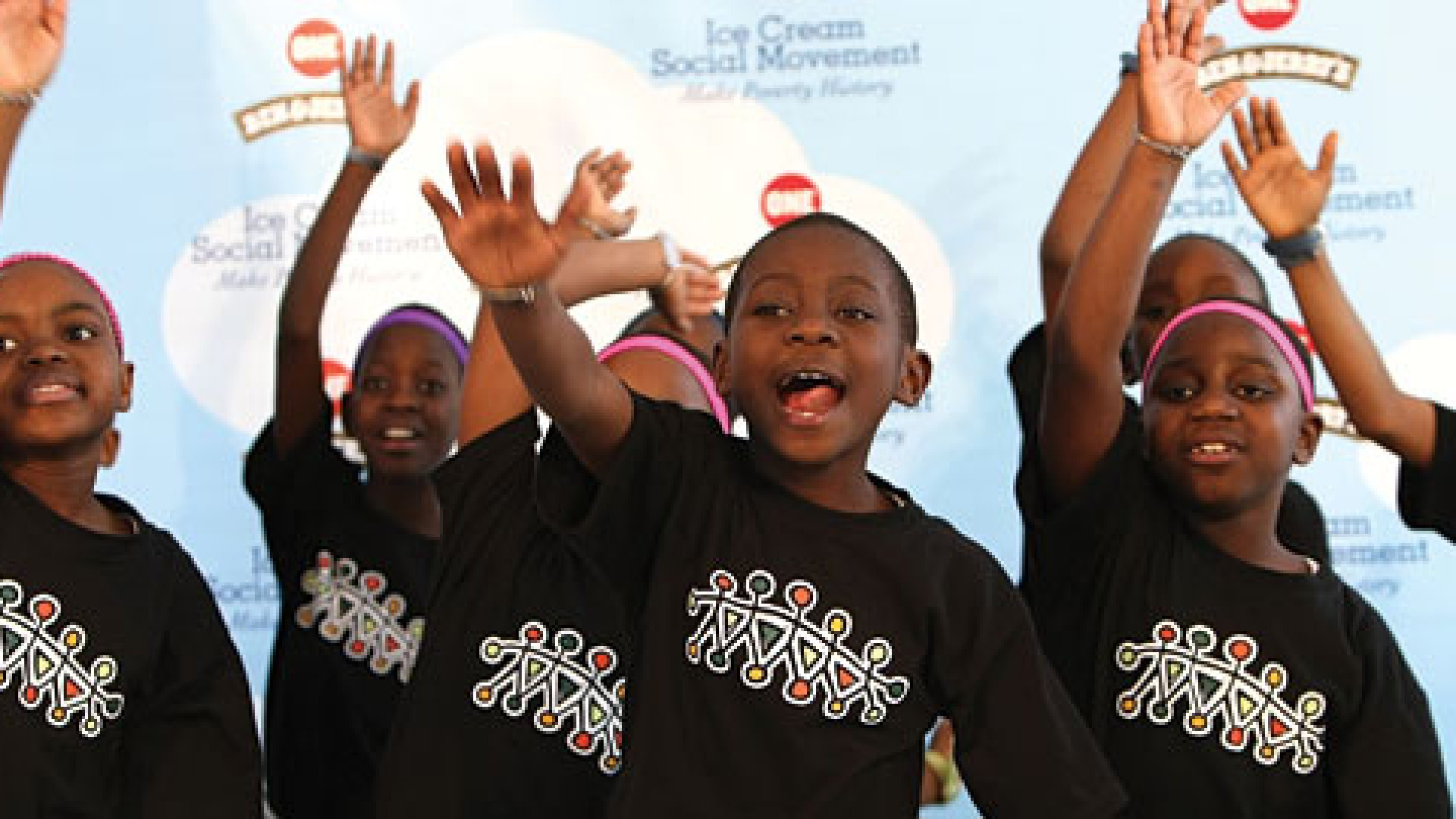 Members of the African Children's Choir perform at the partnership launch of Ben & Jerry's and The ONE campaign's fight against global poverty at a Ben & Jerry's store