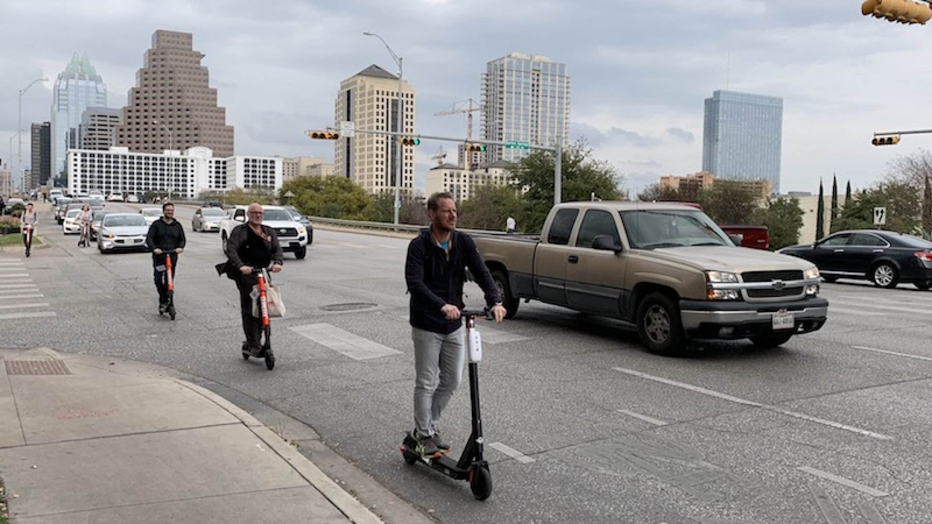 SXSW festival goers riding electric rental scooters between events. Not pictured: helmets.