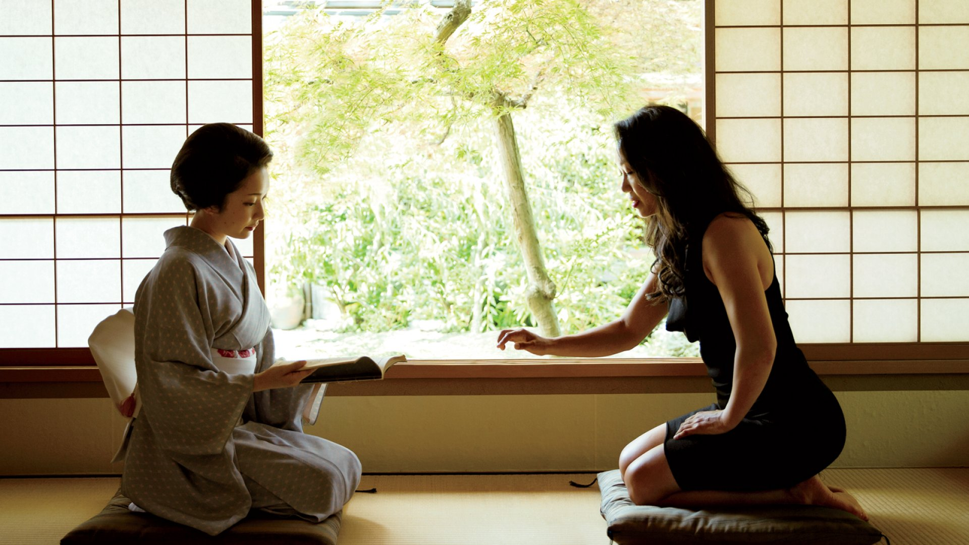 Vicky Tsai (right) and geisha Toshimana discussing beauty rituals at a ryokan-a traditional Japanese guesthouse.