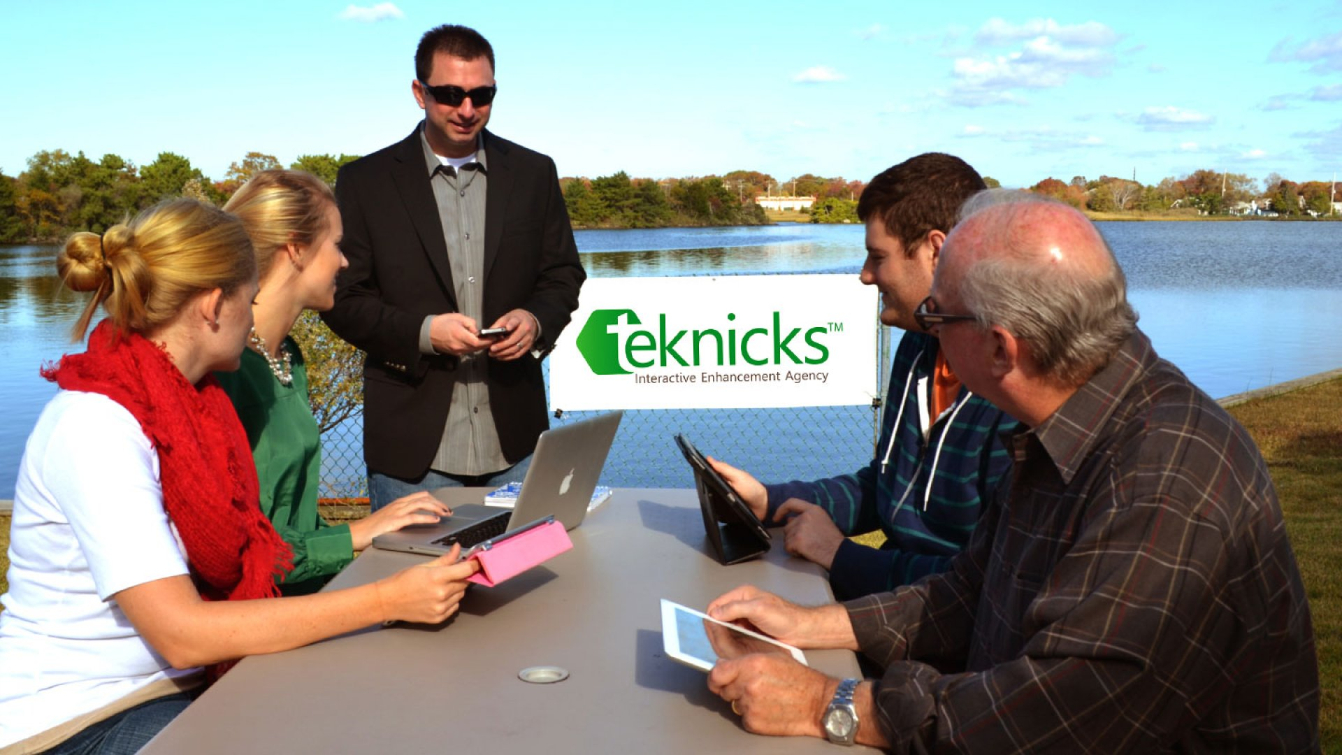 Nick Chasinov meets with staffers at his company's private waterfront courtyard in Bay Head, New Jersey.