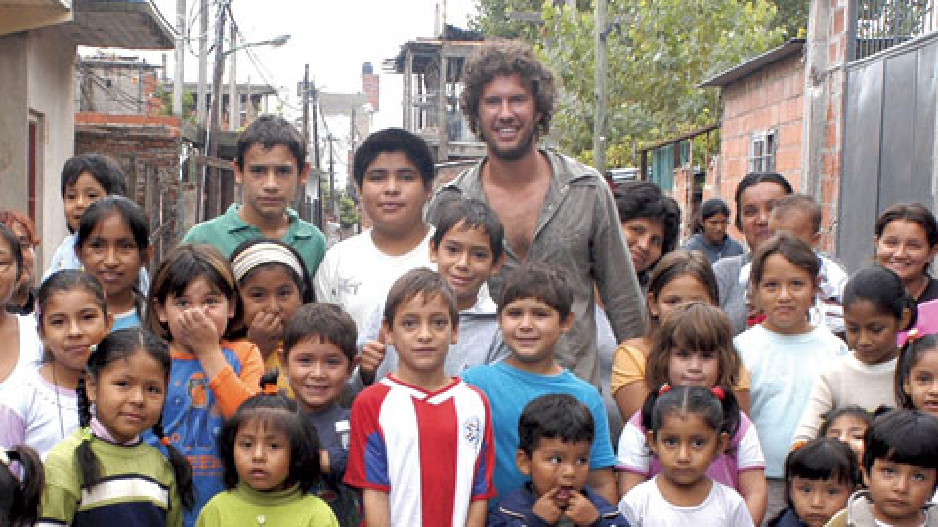 """<strong>SHOE DROP:</strong> TOMS Shoes founder Blake Mycoskie in Los Pelotones for the first """"shoe drop"""" of 10,000 pairs."""