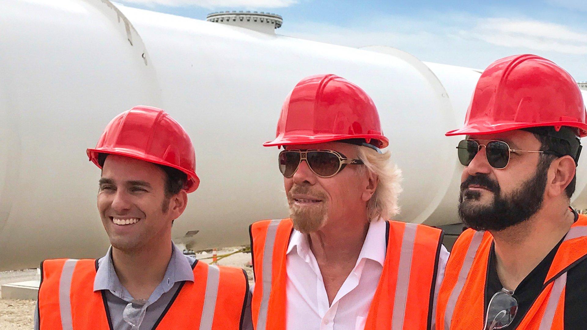 Richard Branson (center) with Hyperloop One's co-founders Shervin Pishevar (left) and Josh Giegel at Hyperloop One's Nevada test track.