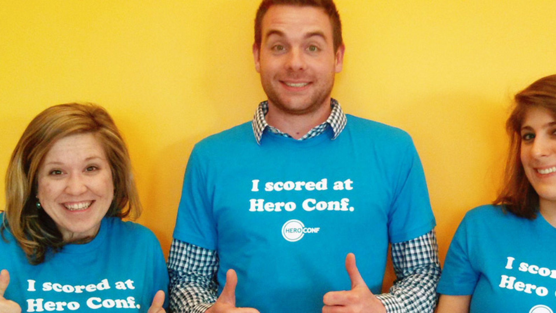 WordStream employees (including Gwozdz, on the left) wearing the t-shirts they handed out at Hanapin Marketing's Hero Conf in Austin.