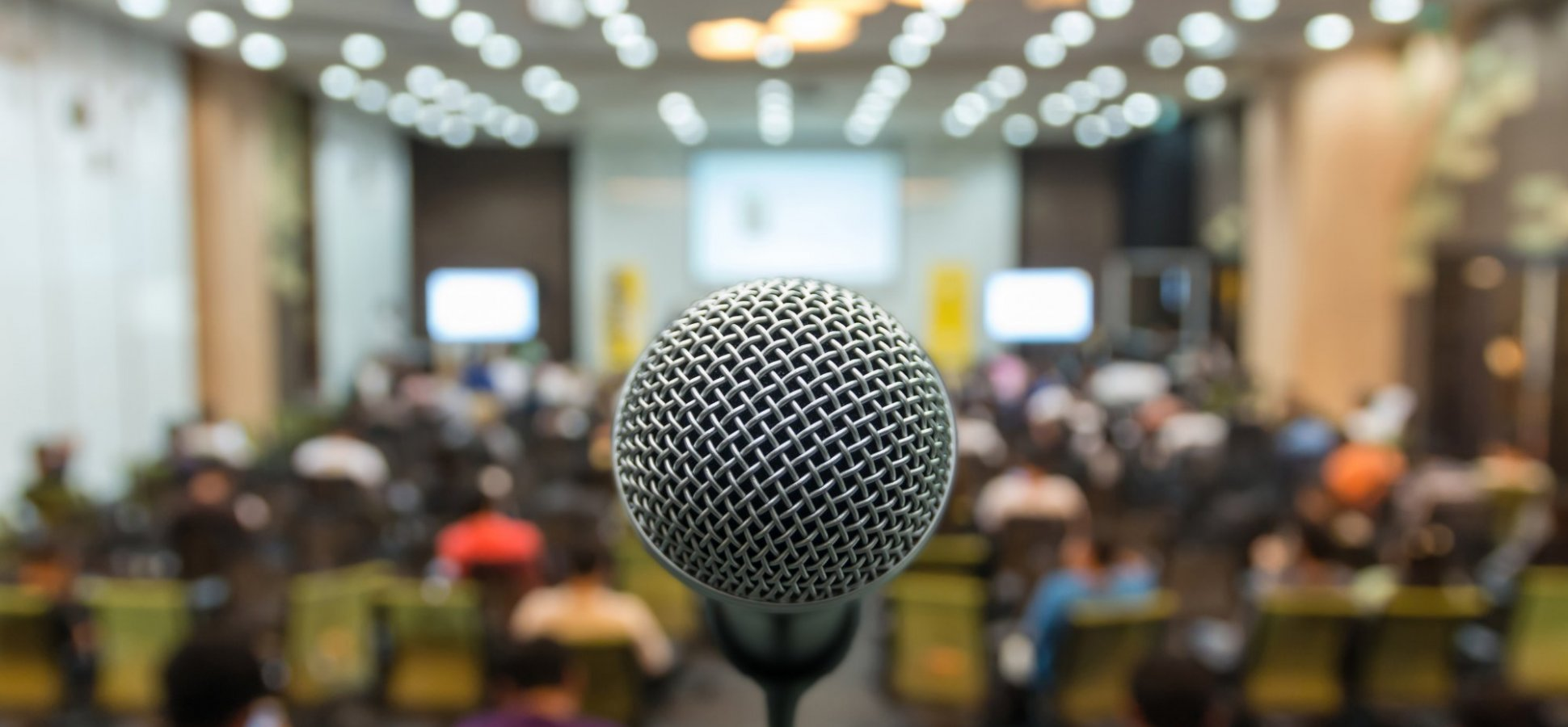 microphone and crowd public speaking
