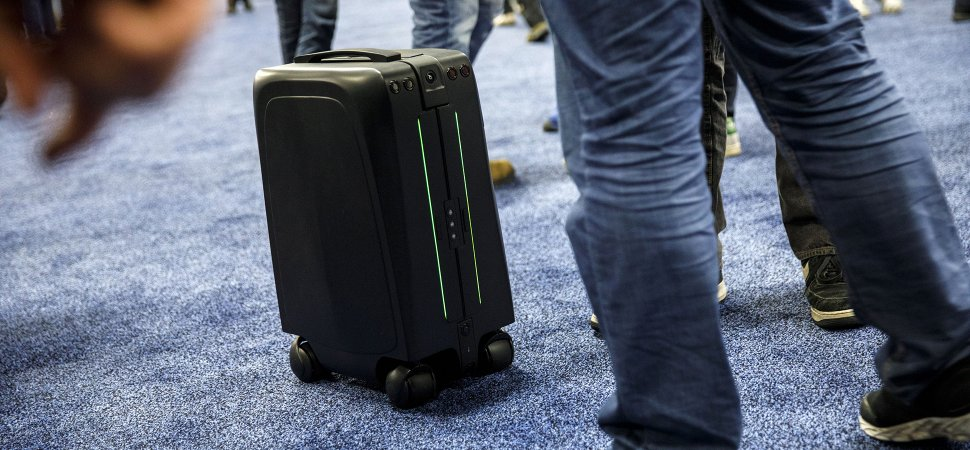 78b397a9578f A ForwardX Robotics CX-1 self-driving intelligent carry-on suitcase moves  through attendees during the CES Unveiled event at the 2018 Consumer  Electronics ...