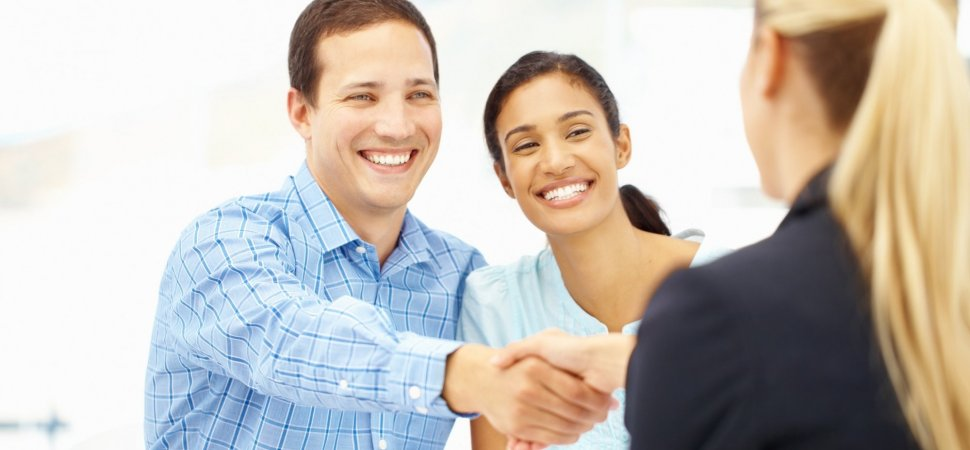 a man shaking a business woman's hand