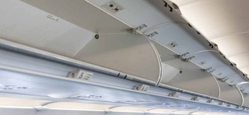 584cb706ab7 American Airlines Announces an Aggressive New Way to Stop Passengers From  Stealing Overhead Bin Space (There s a Catch)