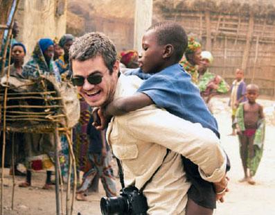 Scott Harrison with a village boy.